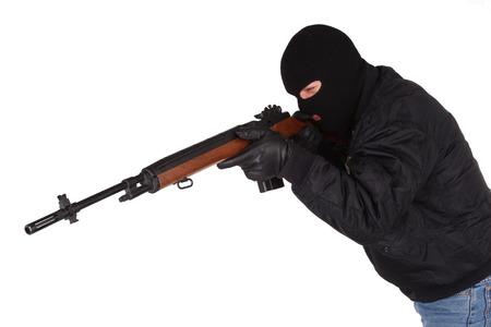 gunman: gunman with rifle isolated on white background