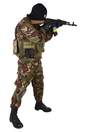 sektor: Ukrainian militiaman with kalashnikov rifle isolated on white Stock Photo