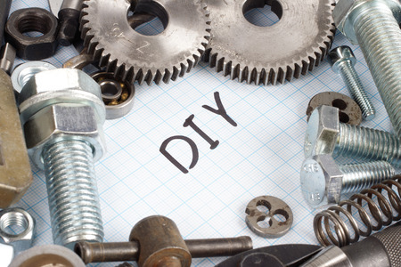 do it yourself: Do it yourself - repair parts on  graph paper background Stock Photo