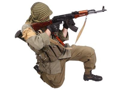 ak 47: insurgent wearing keffiyeh with AK 47 gun isolated on white
