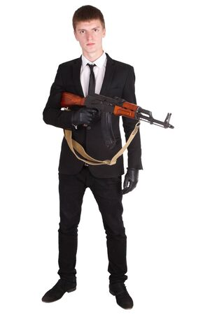 male killer: man in black suit and ak 47 isolated on white
