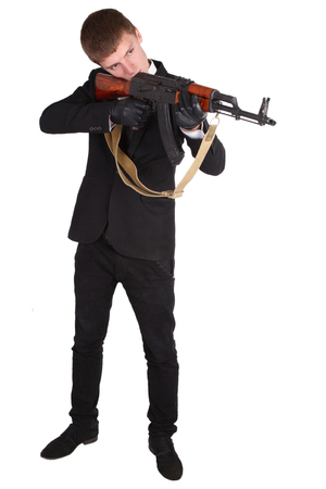 ak 47: man in black suit and ak 47 isolated on white