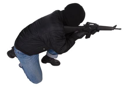 gunman: gunman with M16 rifle isolated on white background