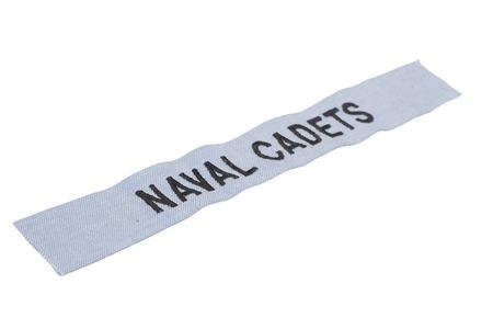 cadet blue: KIEV, UKRAINE - Mar. 29, 2015. Illustrative editorial. US NAVAL CADETS branch tape uniform badge isolated on white background