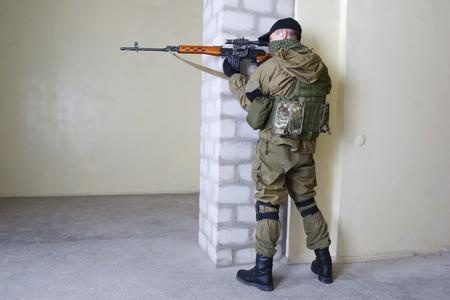 sniper: mercenary sniper with sniper rifle inside the building