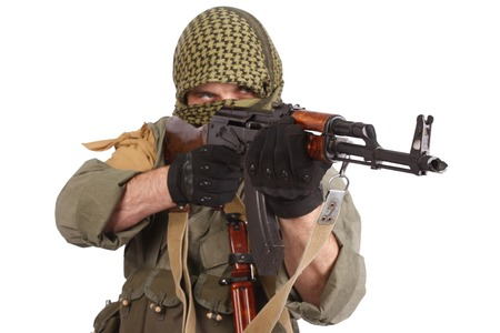 keffiyeh: insurgent wearing keffiyeh with AK 47 gun isolated on white