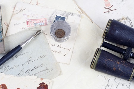 silver coins: Vintage background with old paper, old ink pen, handwriten letters and silver coins Editorial