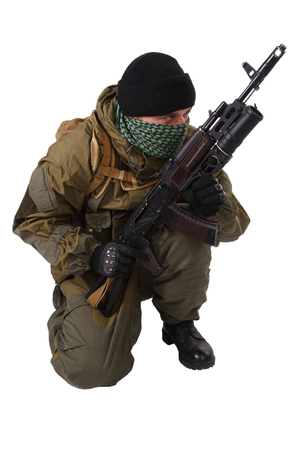 ak 74: terrorist with   rifle with under-barrel grenade launcher isolated on white background