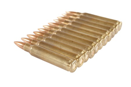 m16 ammo: 5.56 45mm intermediate cartridges isolated on white