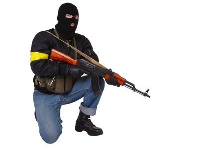 gunman: gunman with AK 47 isolated on white background