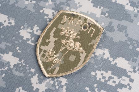 illustrative material: KIEV, UKRAINE - July, 16, 2015. Ukraine Army unofficial uniform badge UKROP