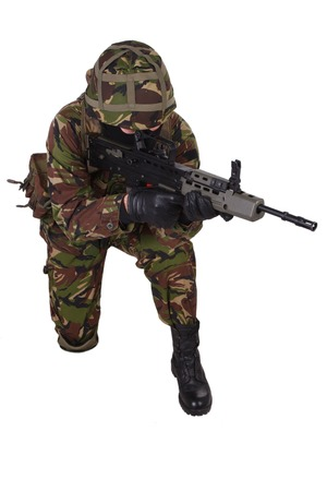 british army: British Army Soldier with assault rifle isolated on white