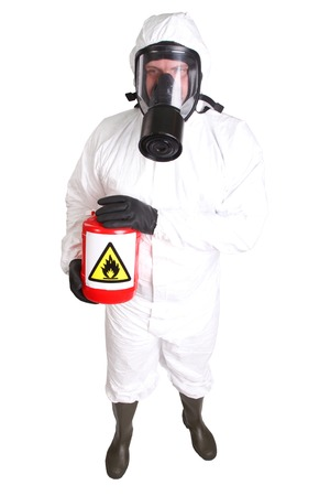Man in a suit of chemical protection isolated on white