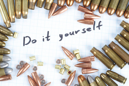 45 caliber: Do It Youself - Reloading cartridges background Stock Photo