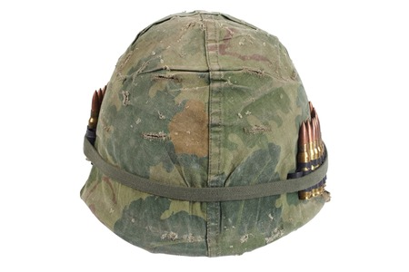 ammo: US Army helmet with camouflage cover and ammo belt - Vietnam war period isolated