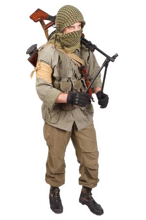 keffiyeh: insurgent wearing keffiyeh with machine gun isolated on white Stock Photo