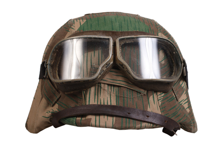 protective goggles: camouflaged nazi german helmet with protective goggles isolated Stock Photo