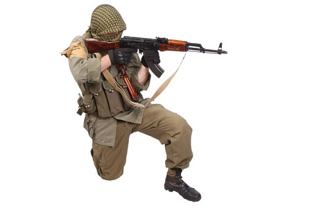 ak 47: shooter with AK 47 isolated on white