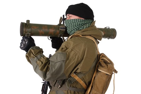 rpg: terrorist with RPG rocket launcher  isolated on white