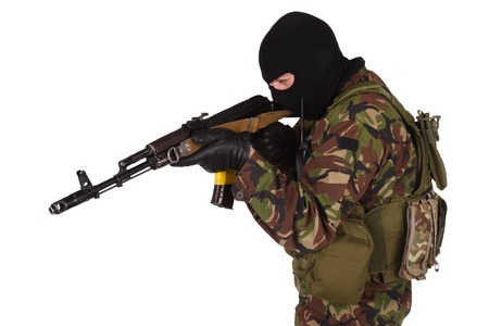 sektor: Ukrainian volunteer with kalashnikov rifle isolated on white