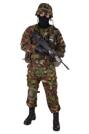 assault: British Army Soldier with assault rifle isolated on white
