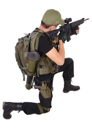 m16: mercenary with m16 rifle isolated on white Foto de archivo