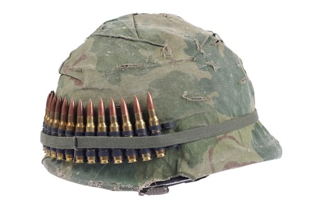 army camo: US Army helmet with camouflage cover and ammo belt - Vietnam war period isolated