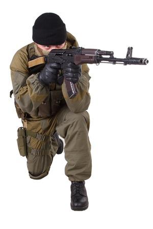 shooter: shooter with kalashnikov rifle isolated on white background