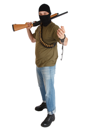 jail break: jail break - robber in black mask with shotgun removing handcuffs