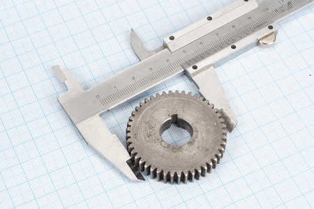 graph paper: gear and caliper on  graph paper background Stock Photo