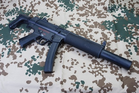9mm ammo: submachine gun MP5 with silencer isolated Stock Photo