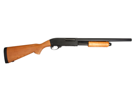 pump action shotgun with a wooden butt isolated on white