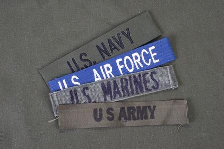 US military concept on olive green uniform background Archivio Fotografico