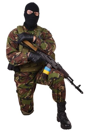 sektor: Ukrainian militiaman with rifle isolated on white