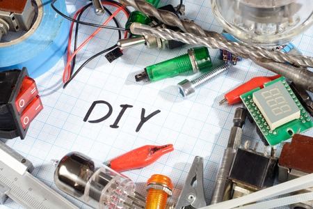 triode: Do it yourself - radio-electronic parts on  graph paper background