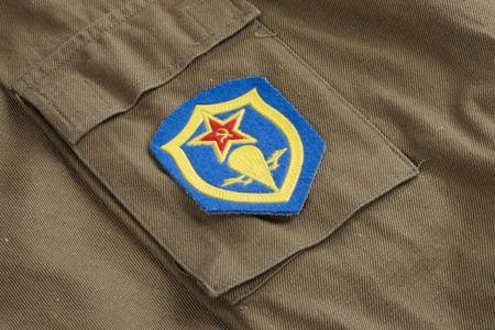 airborne: Soviet Army Airborne forces  shoulder patch on khaki uniform background
