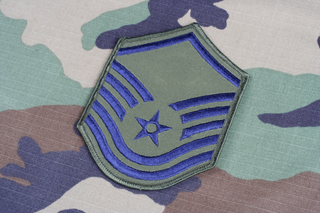 us air force: KIEV, UKRAINE - June 6, 2015.  US AIR FORCE Master Sergeant rank patch on woodland camouflage uniform