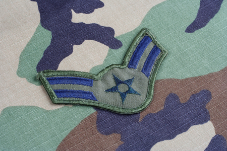 us air force: KIEV, UKRAINE - June 6, 2015. US AIR FORCE Airman First Class rank patch on woodland camouflage uniform Editorial