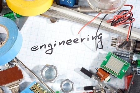 engineering - radio-electronic parts  on  graph paper background