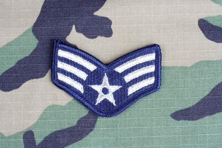 us air force: KIEV, UKRAINE - June 6, 2015. US AIR FORCE Senior Airman rank patch on woodland camouflage uniform