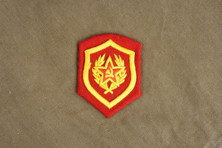 Soviet Army Mechanized infantry shoulder patch on khaki uniform background Stock Photo