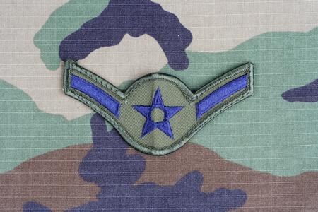 rank: KIEV, UKRAINE - June 6, 2015. US AIR FORCE Airman rank patch on woodland camouflage uniform