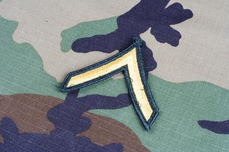 rank: KIEV, UKRAINE - June 6, 2015. US ARMY Private rank patch on woodland camouflage uniform