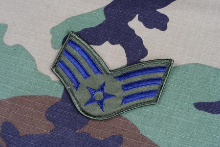 rank: KIEV, UKRAINE - June 6, 2015. US AIR FORCE Senior Airman rank patch on woodland camouflage uniform