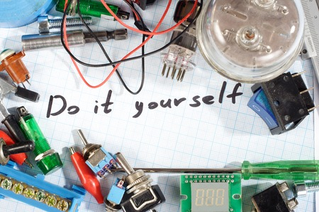 do it yourself: Do it yourself - radio-electronic parts on  graph paper background