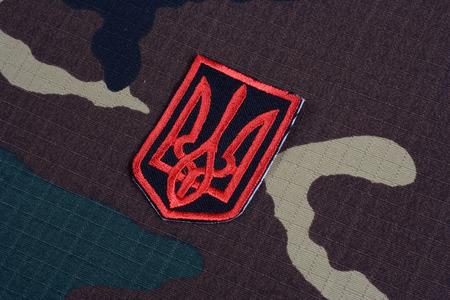 emblem of ukraine: KIEV, UKRAINE - July, 16, 2015.  Ukraine Army uniform badge - trident - Emblem of Ukraine Editorial