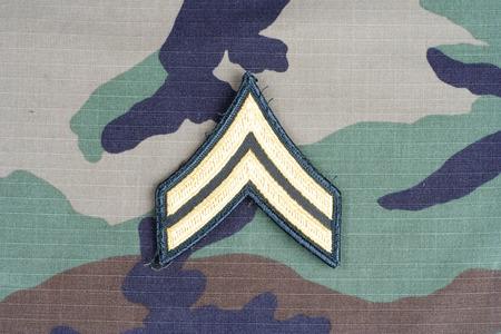 corporal: KIEV, UKRAINE - June 6, 2015. US ARMY Corporal rank patch on woodland camouflage uniform Editorial