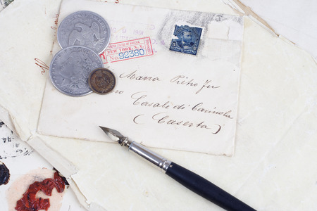 Vintage background with old paper, old ink pen, handwriten letters and silver coins Editorial
