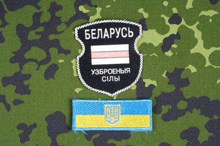 illustrative material: KIEV, UKRAINE - August, 06, 2015. Belarusian volunteers in Ukraine  Army. Russian-Ukraine war 2014 - 2015. Unofficial uniform badge with identification dog-tags Editorial