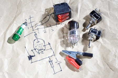 triode: old vacuum tube with electric scheme background